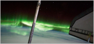 Aurora Australis as seen from the International Space Station, with the port wing of space shuttle Atlantis, and segment of a boom sensor system attached to the shuttle's robotic arm.